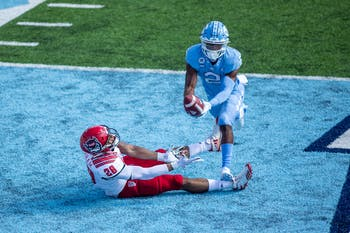 UNC sophomore defensive back Don Chapman (2) intercepts a pass in Kenan Stadium Oct. 24, 2020. The Tar Heels beat the Wolfpack 48-21.