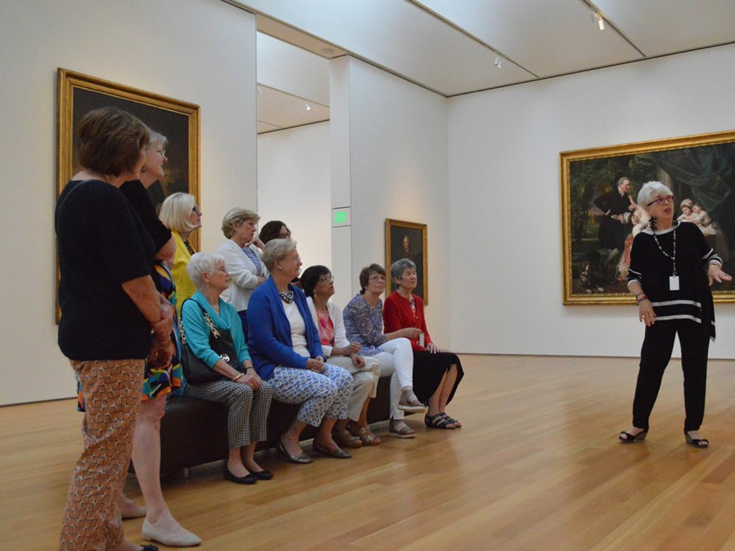 "Docent Rhonda Wilkersen leads women from the Oxford Study Group around the ""History and Mystery"" exhibit in the NC Museum of Art, which showcases the best of the museum's Old Master British paintings and sculptures.  The exhibit is a result of the Scott Project, an effort to unveil the origin of these works by students and faculty from UNC and Duke in partner with the museum."