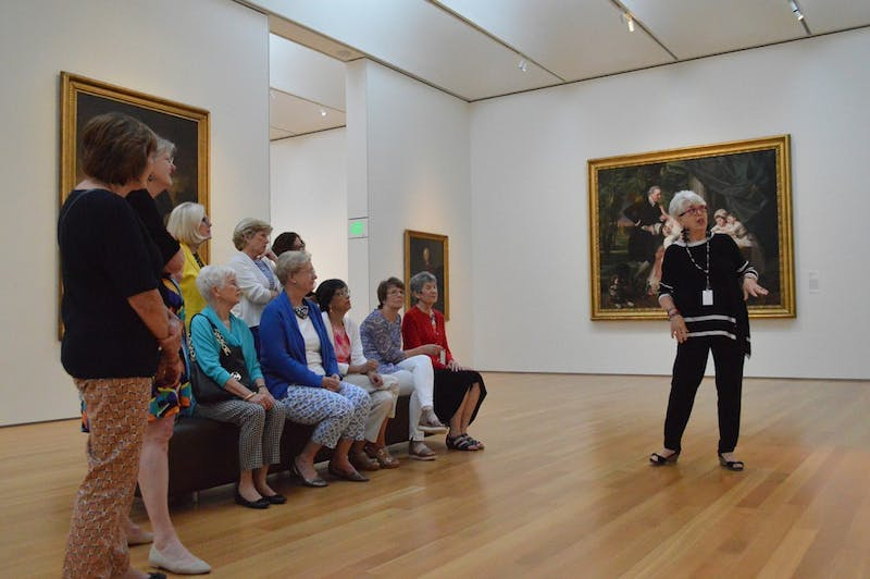 """Docent Rhonda Wilkersen leads women from the Oxford Study Group around the """"History and Mystery"""" exhibit in the NC Museum of Art, which showcases the best of the museum's Old Master British paintings and sculptures.  The exhibit is a result of the Scott Project, an effort to unveil the origin of these works by students and faculty from UNC and Duke in partner with the museum."""