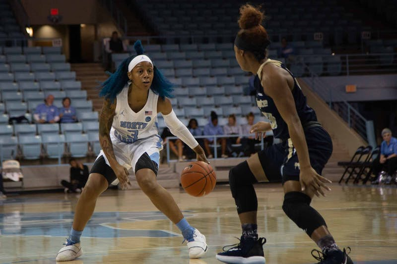 Redshirt senior guard Madinah Muhammad (3) dribbles the ball during exhibiton game against Wingate in the Charmichael Arena on Saturday, Nov. 2, 2019. UNC won 82-37.