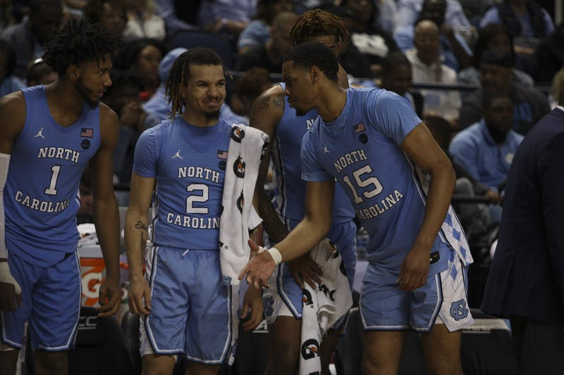 (From left) Sophomore guard Leaky Black (1), first-year guard Cole Anthony (2), and junior forward Garrison Brooks (15) goof around during the first-round game of the ACC tournament against Virginia Tech in the Greensboro Coliseum Complex on Tuesday, March 10, 2020. UNC beat Virginia Tech 78-56.