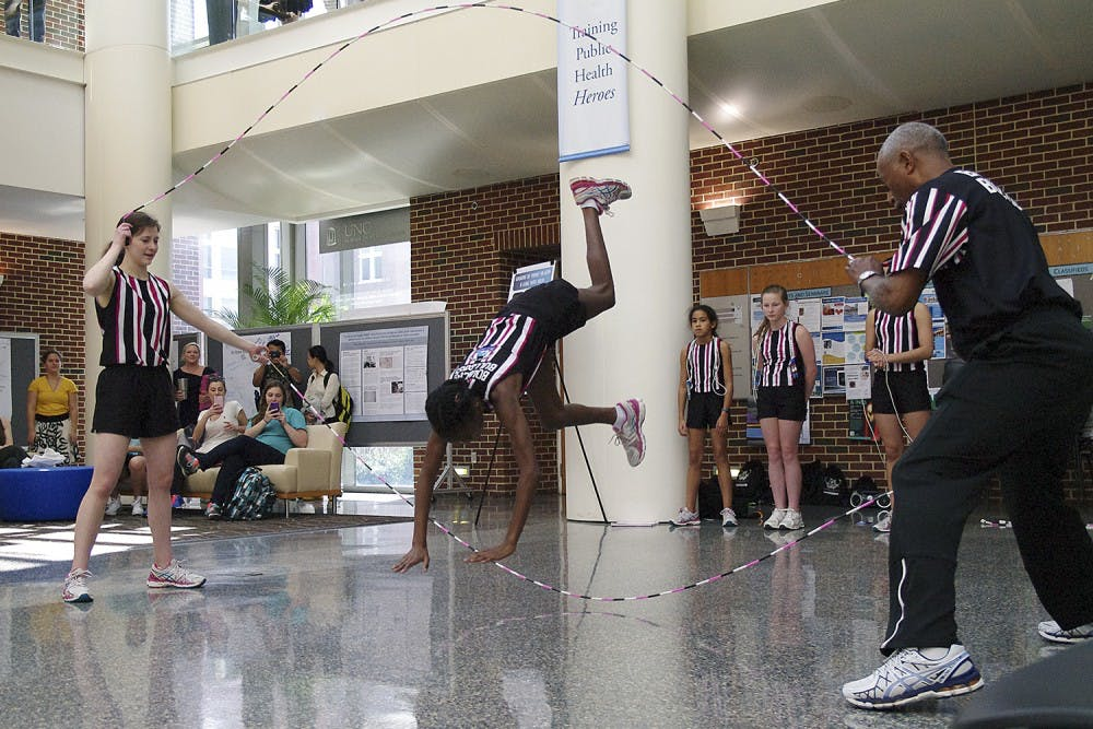 <p>Lena Berry, 12, a member of the Bouncing Bulldogs jump rope demonstration team, performed in the Gillings School of Global Public Health on Wednesday.</p>