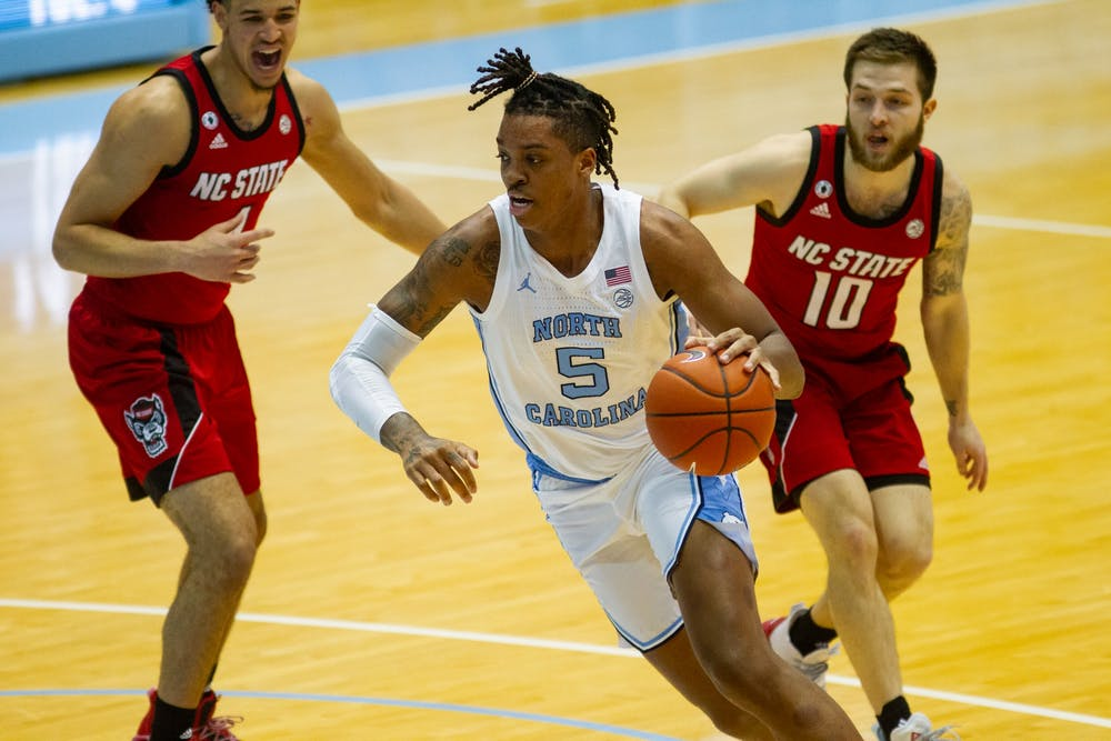 UNC sophomore forward Armando Bacot (5) drives to the basket in the Smith Center during a game against NC State on Saturday, Jan. 23 2021. UNC beat NC State 86-76.
