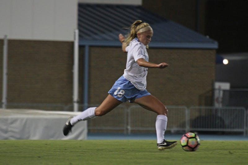 Megan Buckingham (18) dribbles down the field in Thursday night's match against Miami, leading theTar Heels to a 3-1 victory.