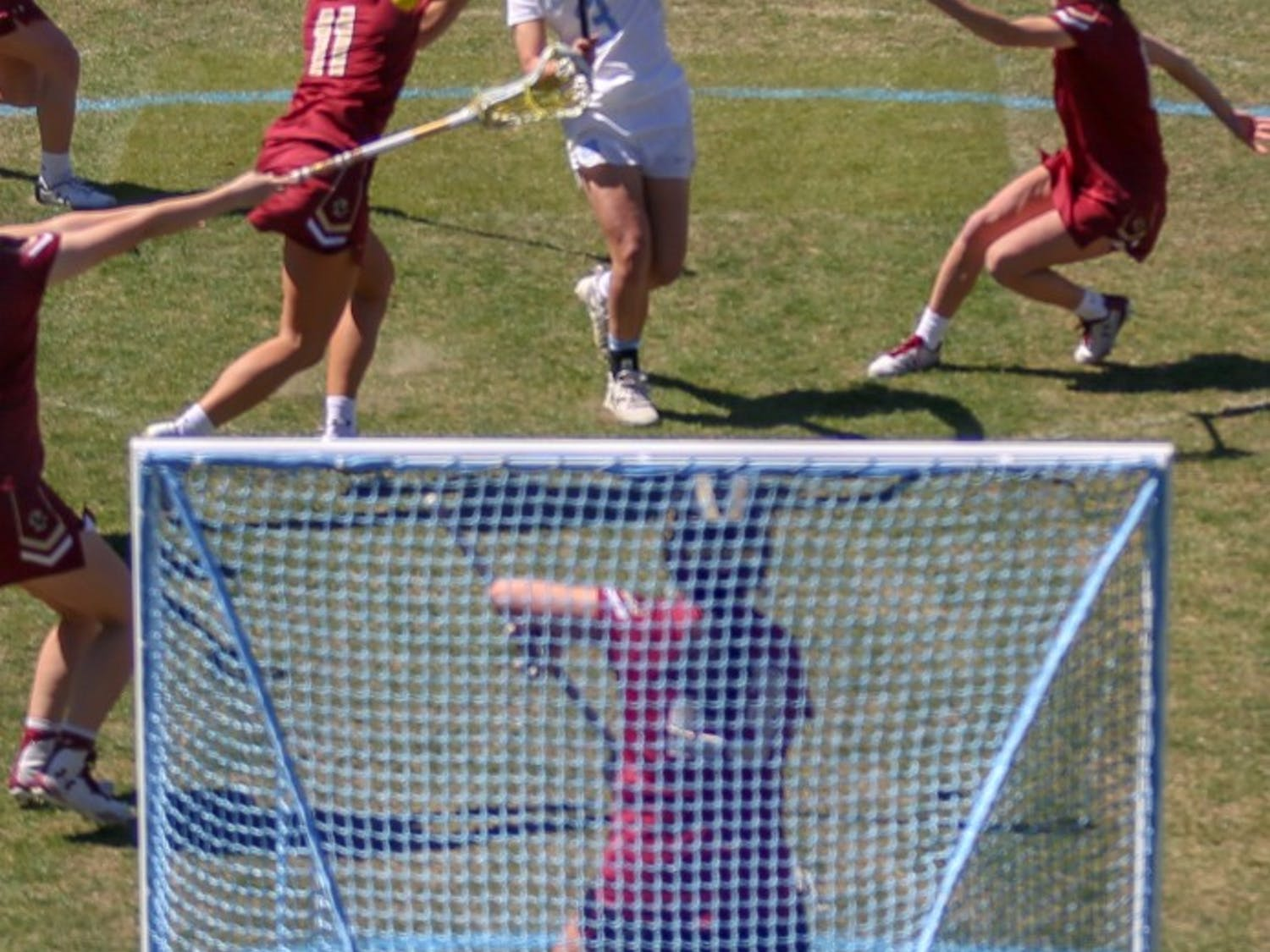 Sophomore attacker Jamie Ortega (3) makes a shot on goal against Boston College at the UNC Lacrosse Stadium on Saturday, March 23, 2019. Boston College defeated UNC 14-8.