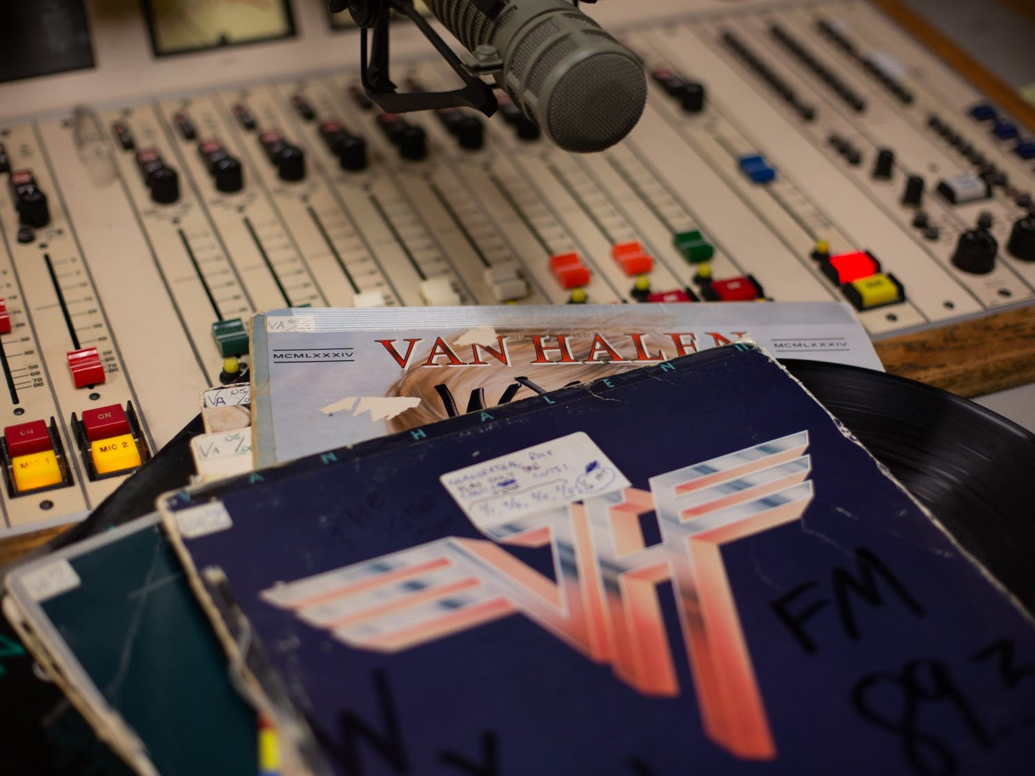 DTH Photo Illustration. A stack of Van Halen records sits on top of a mixing board.