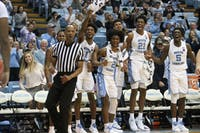 The UNC bench goes wild after forward Brandon Huffman (42) dunks on Tennessee Tech on Friday, Nov. 18, 2018 in the Smith Center.