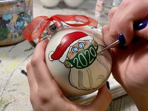 Junior Anna Eskew paints a Christmas ornament on Nov. 30, 2020. Photo courtesy of Anna Eskew.