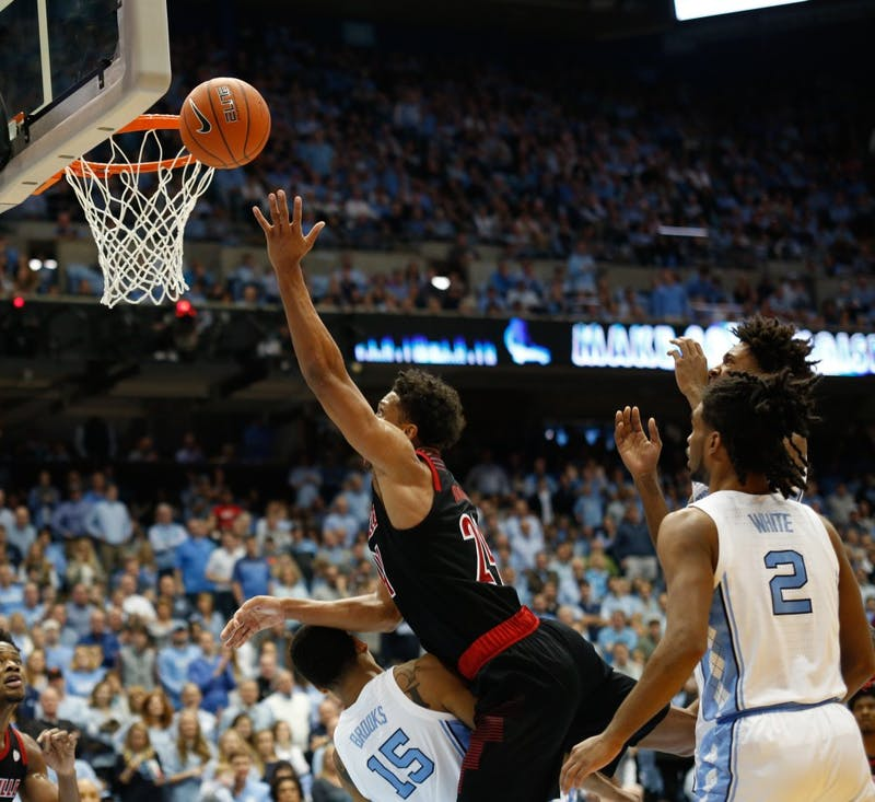 Louisville forward Dwayne Sutton (24) shoots the ball during the game against UNC at the Smith Center Saturday, Jan. 12, 2019. Louisville beat UNC 83-62.