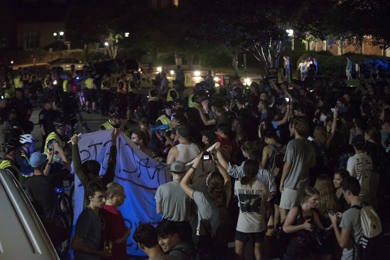 Counter-demonstrators gather in Morehead Planetarium as demonstrators exit on Thursday night.