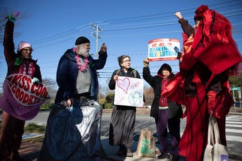 Members of the community protest in front of the coal power plant on Cameron Avenue on Friday, Feb. 14, 2020. The protestors have gathered here every Friday morning since May 2019 to protest the coal plant operation.