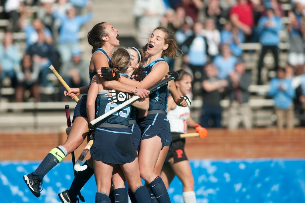 <p>UNC field hockey players come together in celebration after their second goal against Princeton University at the NCAA Championship Game at Kentner Stadium on Sunday, Nov. 24, 2019. UNC won 6-1, marking their 8th national championship.</p>