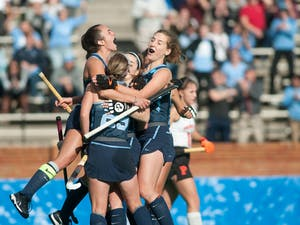 UNC field hockey players come together in celebration after their second goal against Princeton University at the NCAA Championship Game at Kentner Stadium on Sunday, Nov. 24, 2019. UNC won 6-1, marking their 8th national championship.