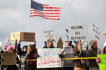 Protesters gather outside terminal two at RDU Airport Sunday in response to President Donald Trump's executive order banning immigrants from certain countries from entering the U.S.
