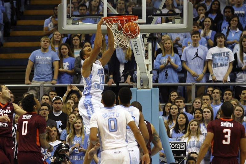 UNC junior forward Brice Johnson (11) dunks the ball.