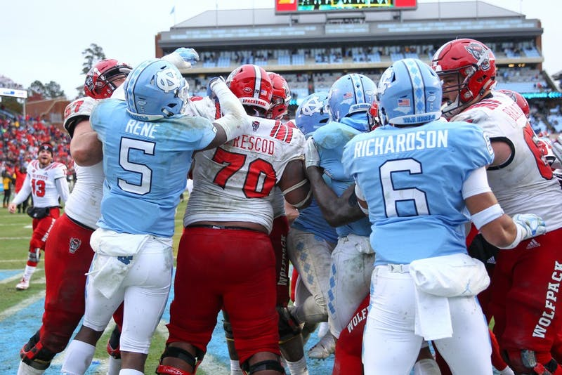 UNC and NC State players fight in a post-game brawl on Saturday, Nov. 24 in Kenan Memorial Stadium. NC State beat UNC 34-28 in overtime.