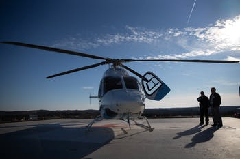 Mike Gardner, Carolina Air Care ground critical care paramedic and Alan Wolf, UNC Health Care spokesperson, stand with Tar Heel 1 at the helipad at UNC Medical Center on Friday, Jan. 17, 2020. Carolina Air Care is the only true 24/7 neonatal pediatric special care team in North Carolina.