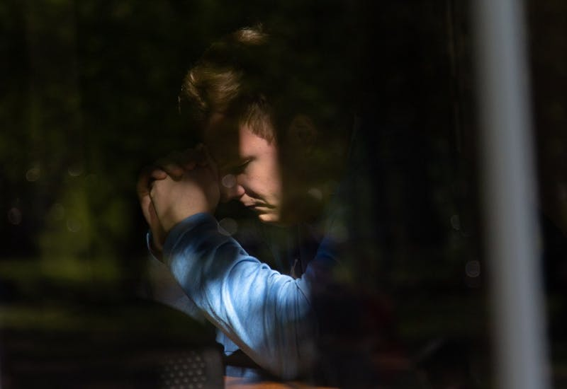 "Austin Kliewer, junior exercise and sports science major, prays during UNC week of 24/7 prayer at the North Carolina Study Center, April 16, 2019. UNC week of 24/7 prayer began on April 10 and ends on April 17 and students sign up for timeslots to pray with a stranger. This was Kliewer's first time participating in the event. ""Just praying in general for everyone on campus - both believers and non-believers - I think is one of the most powerful things you can do is just talk to the creater of the world, going on their behalf is just amazing,"" Kliewer said."