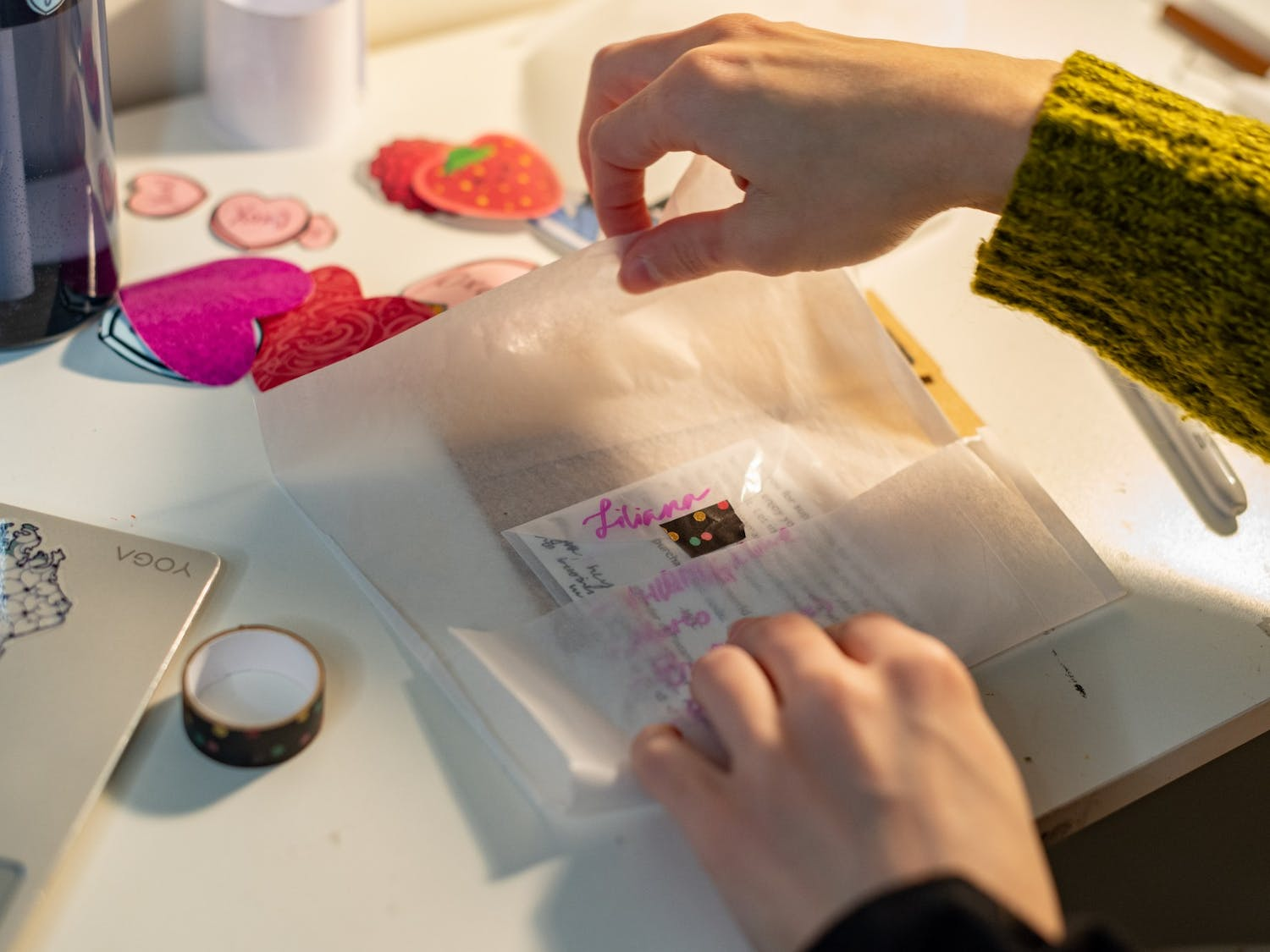Senior Marina Carolina Fela-Castillo packages a sticker order on Monday, Feb. 15, 2021. Fela-Castillo customizes each element of her packaging for customers with hand-written notes and hand-drawn designs.
