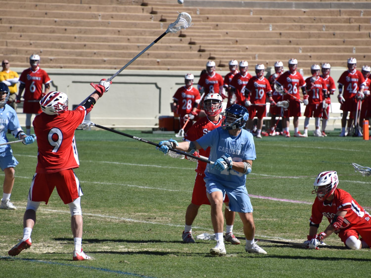 UNC junior midfielder Andy Matthews (12) battles for the ball against two St. John's defenders on March 3 at Kenan Stadium.