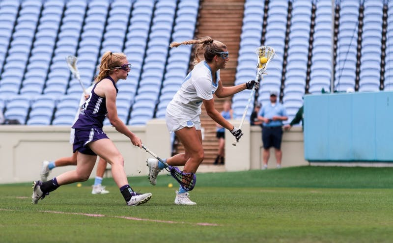 North Carolina attacker Ela Hazar (7) moves down the field in possession of the ball during Saturday's NCAA quarterfinal win against Northwestern.