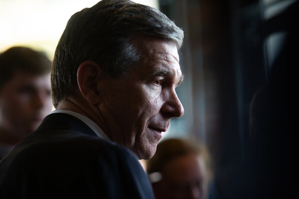 <p>Gov. Roy Cooper stands before members of the media following a press conference introducing Well Dot Inc. to the Chapel Hill area on Tuesday, Nov. 19, 2019.</p>