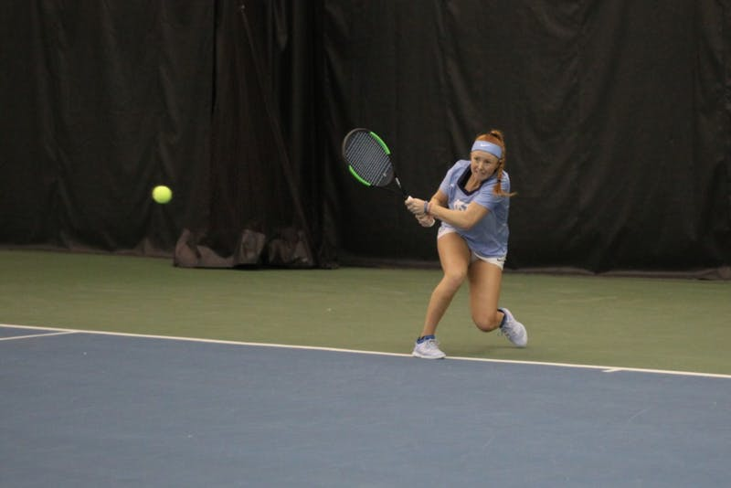 Junior Sara Daavettila takes a shot during her singles match against Virginia Commonwealth University on Jan. 26, 2019.