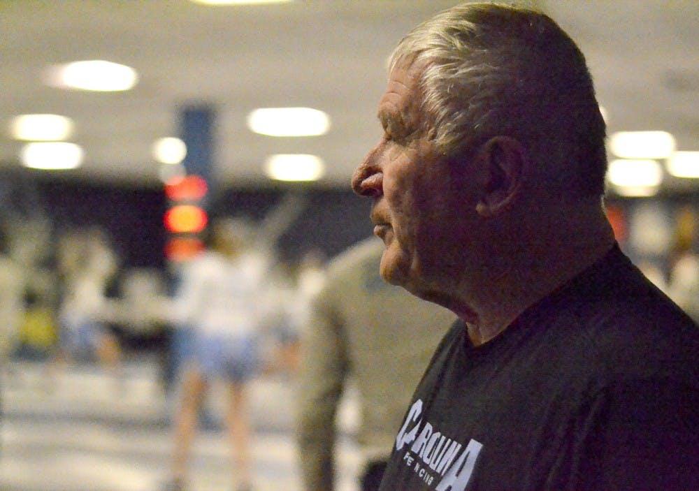 UNC fencing coach Ron Miller inspires team
