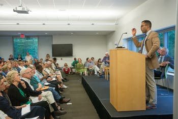 """William Sturkey speaking at an Aug. 30, 2017 event titled, """"Beyond the Headlines: Confederate Monuments, Historical Memory, & Free Speech"""" at the Chapel Hill Public Library. Photo courtesy of Andrew Kornylak."""