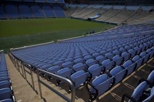 New Carolina blue seats are installed in Kenan Memorial Stadium on September 29th, 2018.