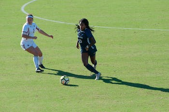 Midfielder (8) Brianna Pinto drives down the field during Thursday's game against Boston College.