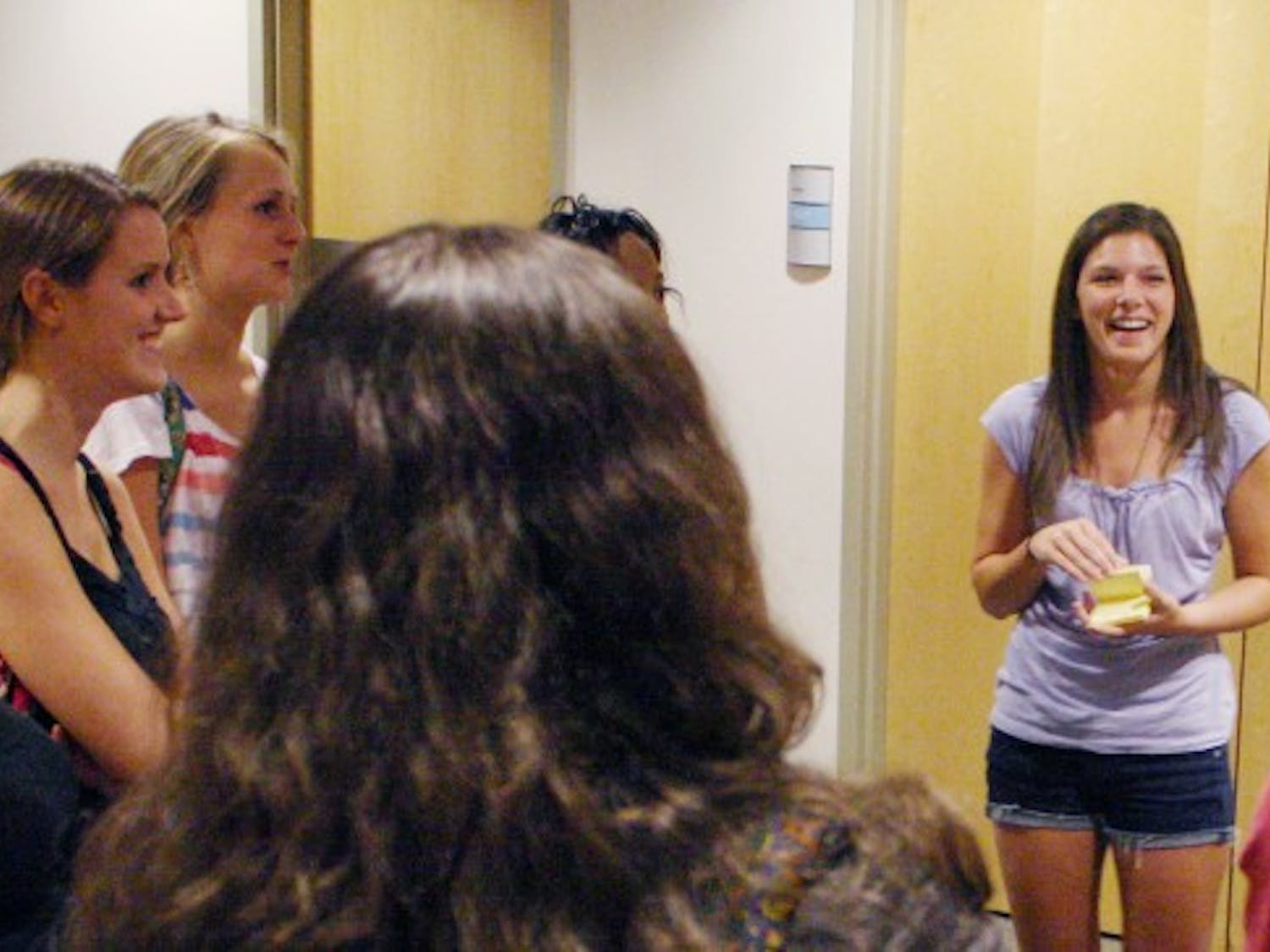 Brittany Greene, a senior Business Administration major, leads an icebreaker with a group of students. Greene is the treasurer of Carolina First, an organization that welcomes first generation college students at UNC. The executive board expected about 100 students to show up to the program.