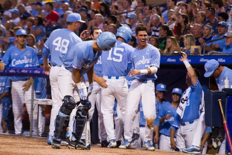 Carolina baseball players congratulate one another during the game on May 23.