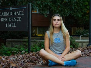 Fiona Crawley, a first-year on the UNC Women's Tennis team, sits in front of her residence hall after getting back from tennis practice on Monday, Oct. 26, 2020.