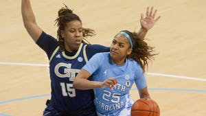 UNC first year guard Deja Kelly (25) dribbles the ball during the Tar Heels 89-59 win against Georgia Tech on Thursday, Feb. 25, 2021 at Carmichael Arena in Chapel Hill, NC.