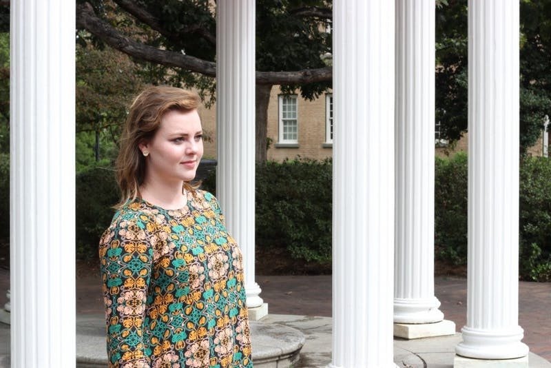 UNC junior Mallory Hoffman poses for a portrait at the Old Well on Tuesday Sept. 26.