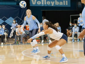 UNC junior libero Karenna Wurl passes the ball at the game against Wofford on Sept. 4 at Carmichael Arena. The Tar Heels won 3-0.