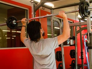 A student lifts weights at the Lark Gym on Wednesday Jan. 27 2021.