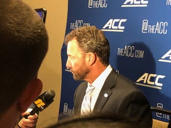 Larry Fedora conducting a press conference at the 2018 ACC Kickoff in Charlotte.