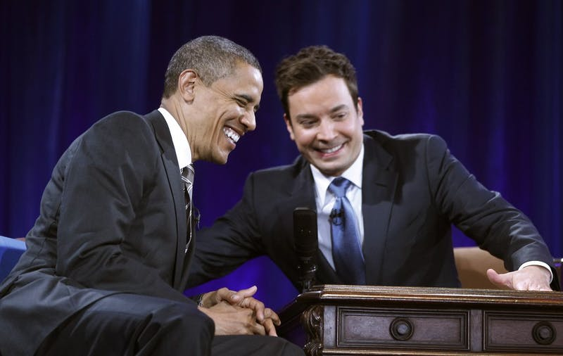 President Barack Obama  laughs as he tapes an appearance on the Jimmy Fallon show at Memorial Hall on the  UNC campus in Chapel Hill, N.C. Tuesday April 24, 2012. POOL PHOTO/CHUCK LIDDY/ THE NEWS & OBSERVER