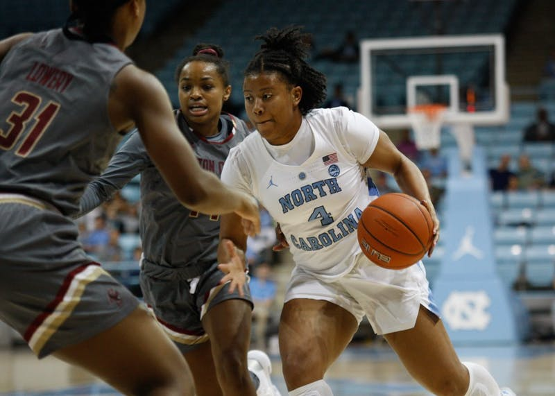 UNC redshirt sophomore guard Jocelyn Jones (4) dribbles the ball during a game against Boston College on Thursday, Feb. 21, 2019 in Carmichael Arena.