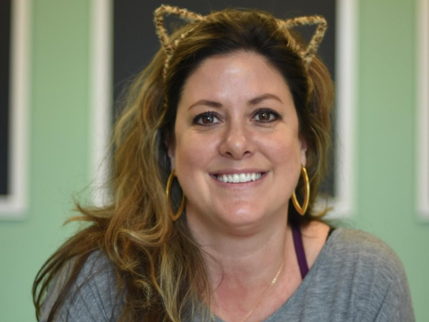 Katy Poitras is one of the managers of Cat Tales Cat Cafe, a low stress place for adoptable cats and cat lovers to meet and socialize.