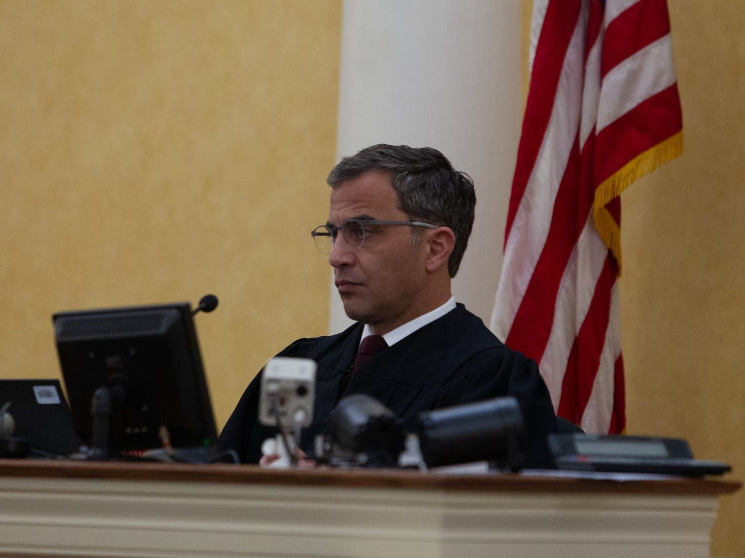 Judge Allen Baddour looks on as SCV lawyer Boyd Sturges speaks during the hearing on Wednesday. Feb. 12, 2020. Judge Baddour ruled to vacate the consent order and dismiss the lawsuit regarding Silent Sam.