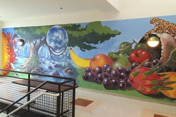 Muralists Carlos Veras and Anthony Vasquez created two symbolic murals in Carrboro High School. Photo courtesy of Chapel Hill-Carrboro City School.