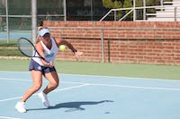 Makenna Jones hits a volley against Virginia on April 13 at the Cone-Kenfield Tennis Center.