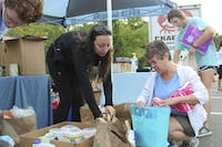 """(From left to right) Jed Higdon, Luisa Brooks, Michele Fulton and Jessica Bevard sort donated items at the """"Fill the Truck"""" relief drive for Hurricane Florence early Tuesday morning on Oct. 9, 2018."""