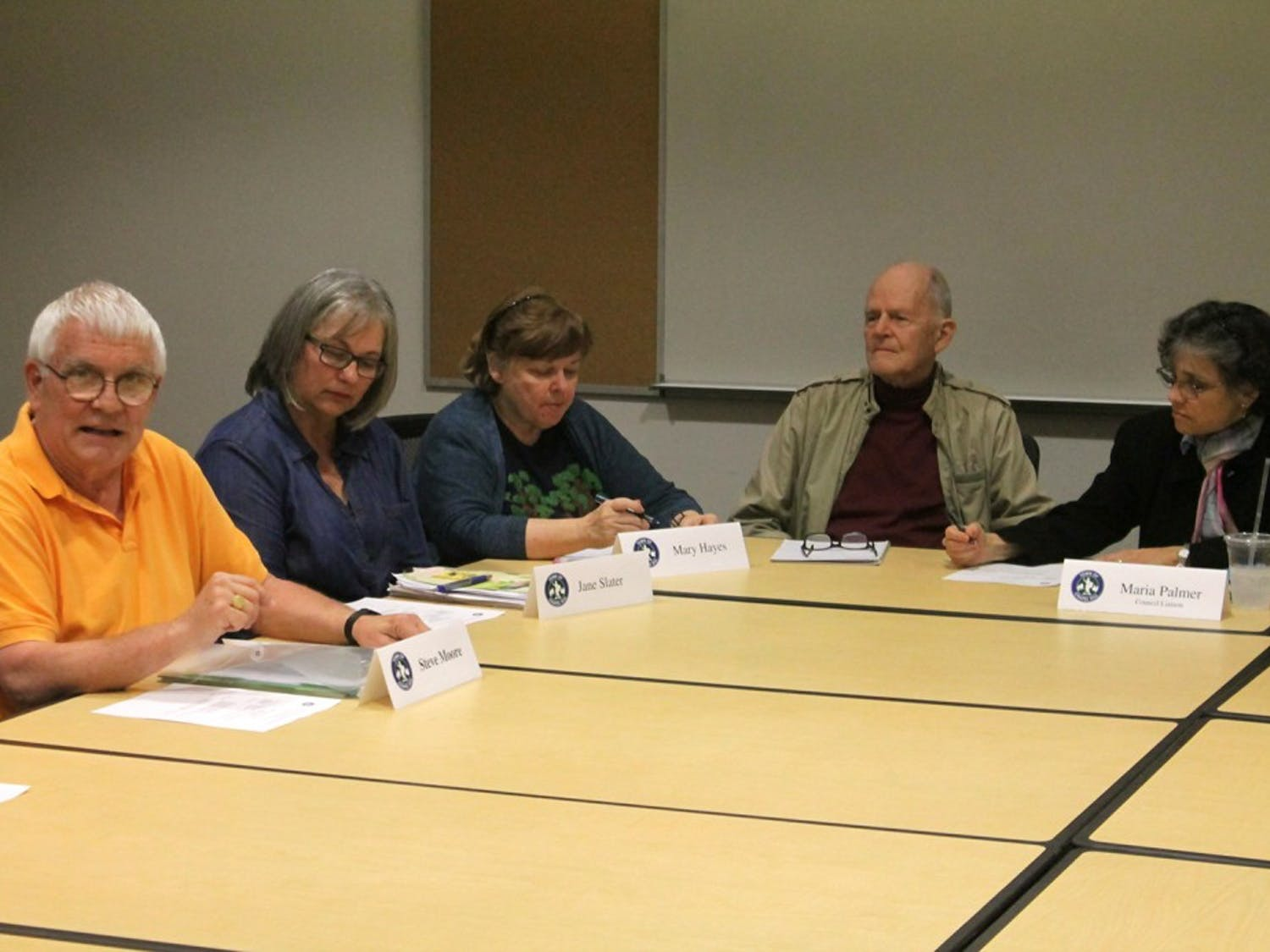 (Left) Steve Moore, Jane Slater, Mary Hayes, Sanley Peele, and Maria Palmer discuss a removed memorial during the Cemetery Advisory Board Meeting Wednesday.