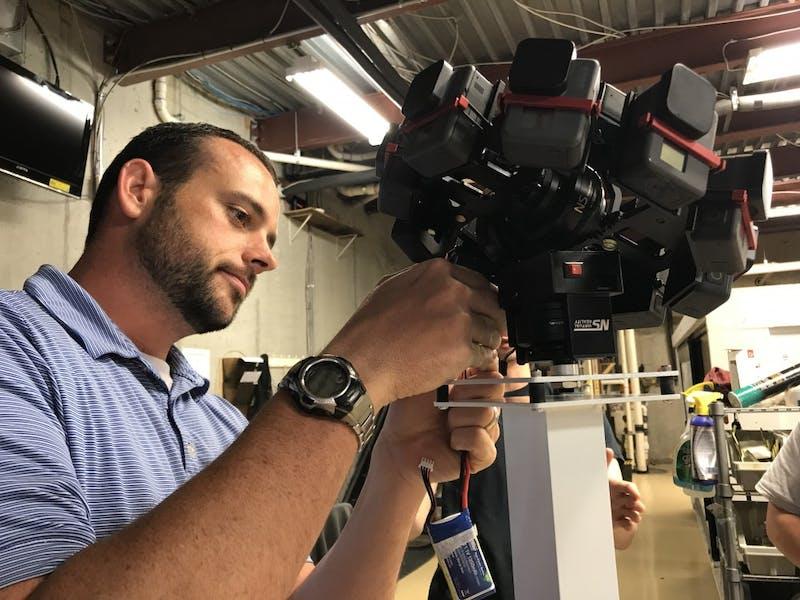 UNC professor Steven King works on his robot, DuCille. Photo courtesy of Steven King