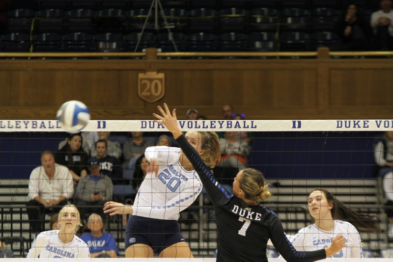 First Year Ava Bell (20) spikes the ball during the game against Duke on Saturday, Nov. 17 at Cameron Stadium. UNC won 3 to 2.