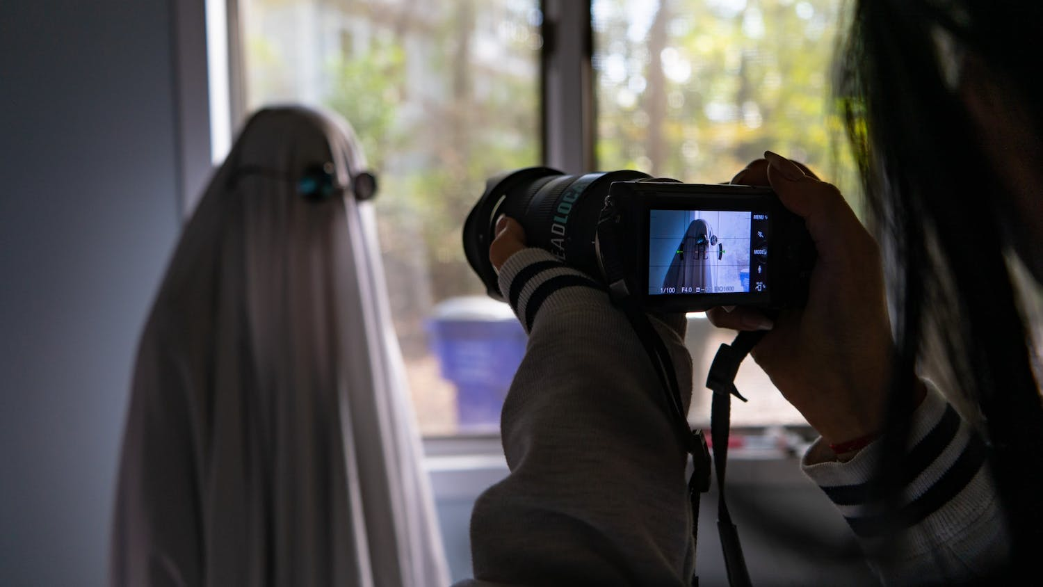DTH Photo Illustration. Many students have been taking part in various TikTok trends, such as ghost photoshoots or wearing wigs.